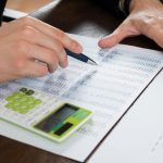 Businessperson Working With Accounting Document